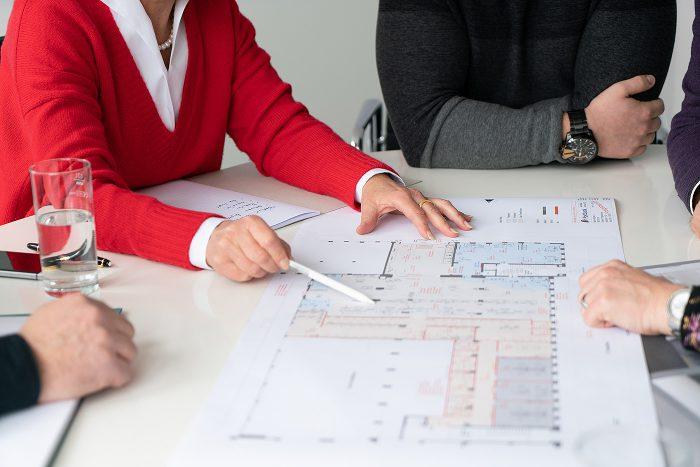 scopio Unternehmen Team persönliche Beratung eines Kunden